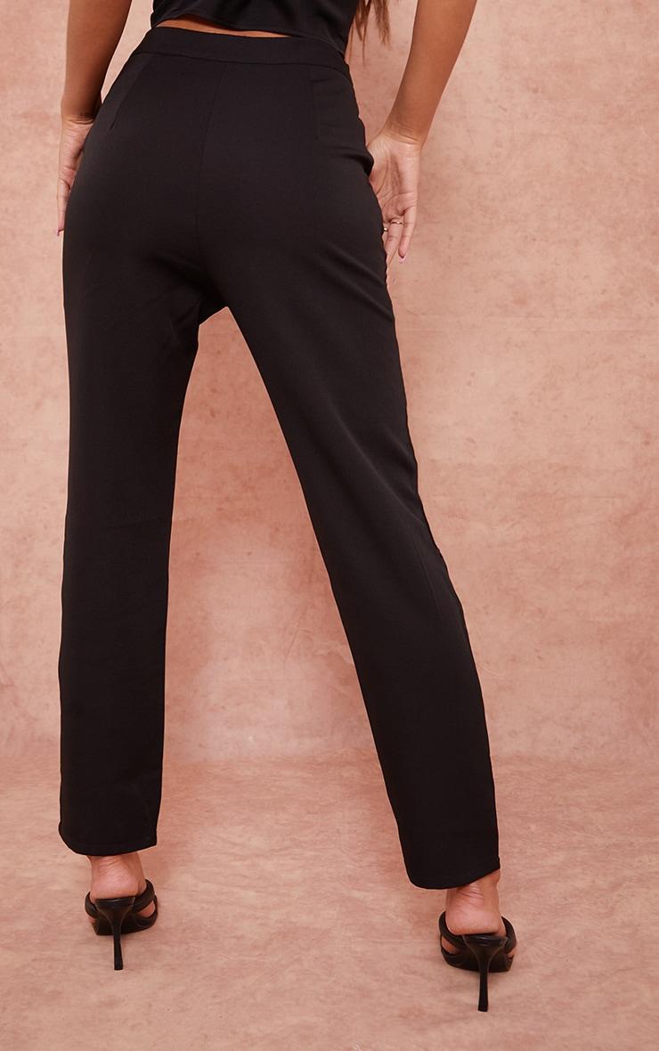 Pantalon cigarette en maille tissée noir détail poches 3