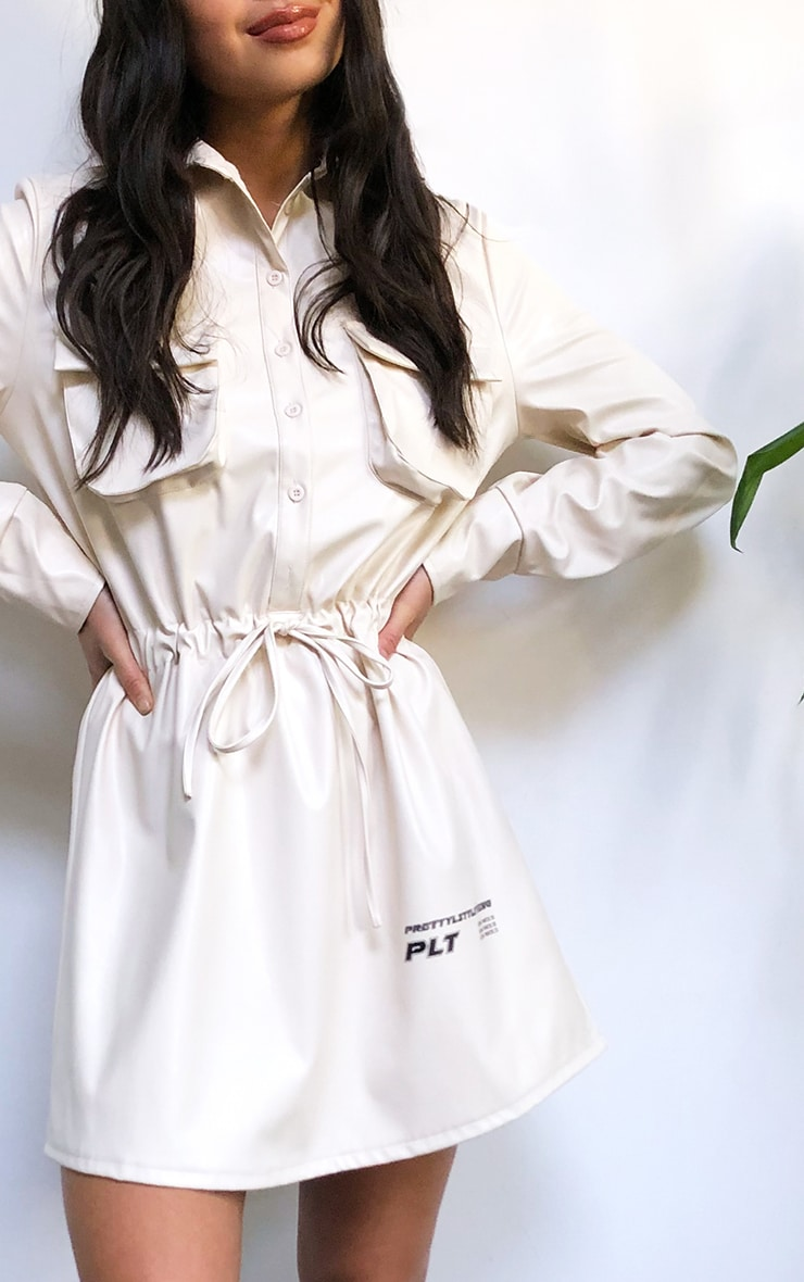PRETTYLITTLETHING Cream Faux Leather Slogan Pocket Detail Shirt Dress 4