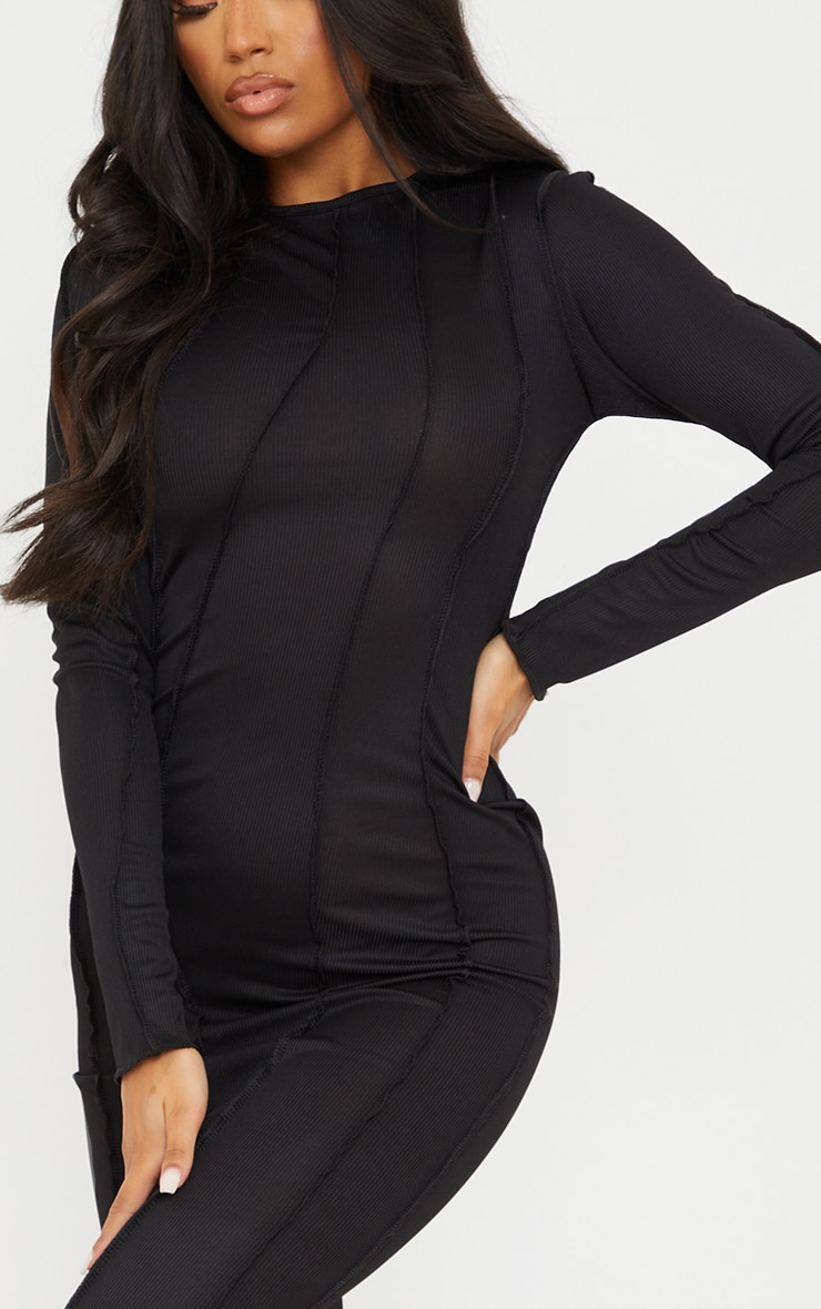 Robe longue noire manches longues côtelée à coutures asymétriques 4