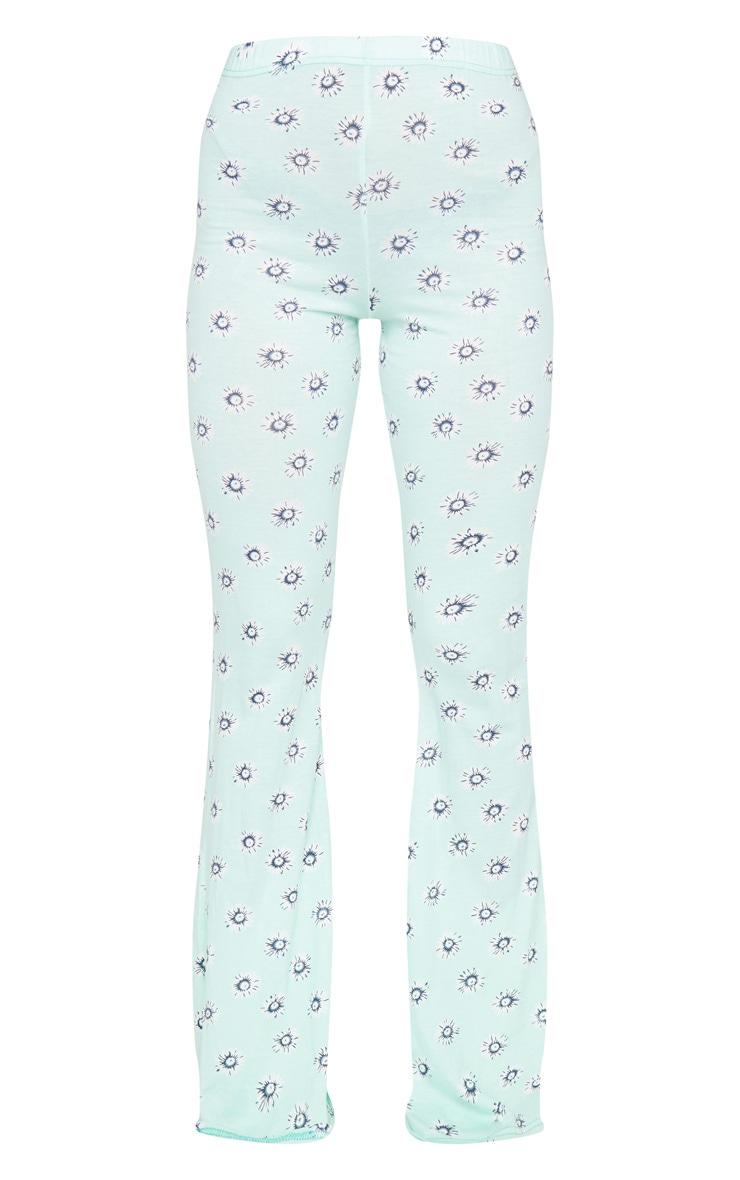 Pantalon en jersey menthe imprimé pâquerettes à taille haute et jambes évasées 5