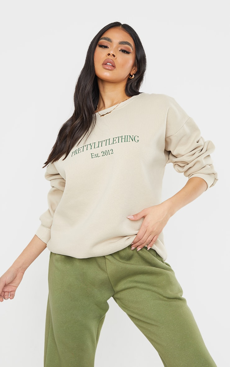 PRETTYLITTLETHING Sand Est 2012 Slogan Embroidered Sweatshirt 1