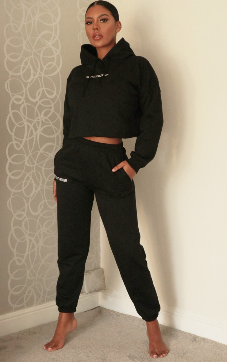 PRETTYLITTLETHING Black Embroidered Slogan Joggers 1
