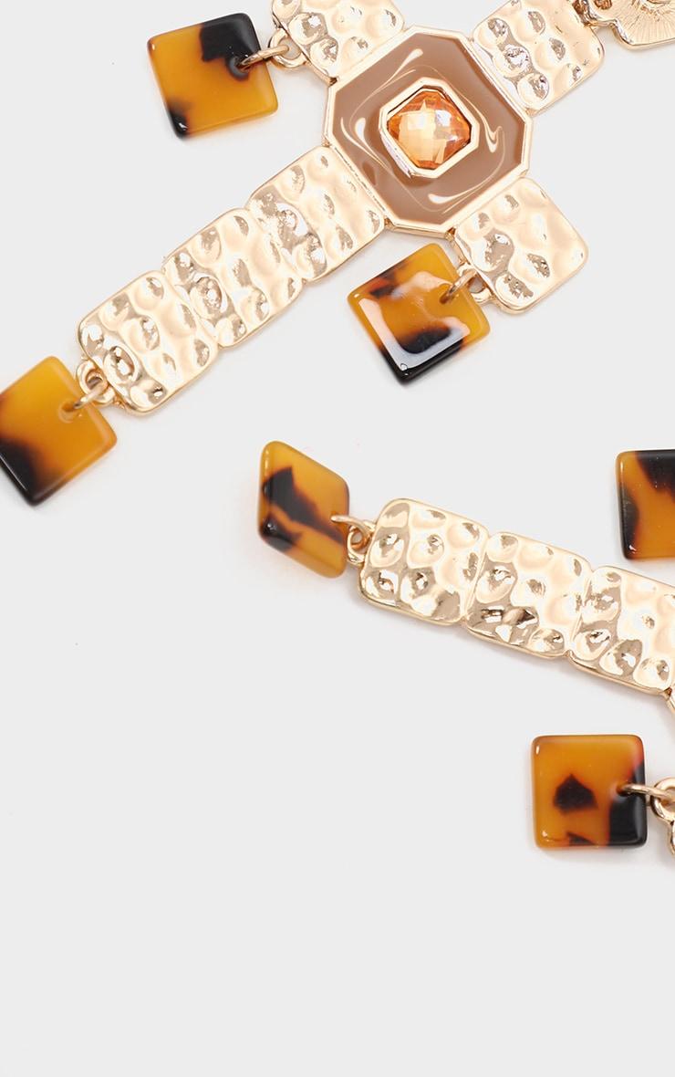 Boucles d'oreilles dorées à pendants croix & détails écaille de tortue 3