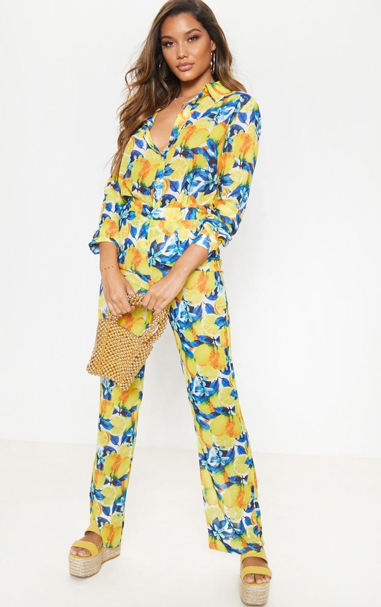 Pantalon de plage jaune imprimé citron à jambes évasées 1