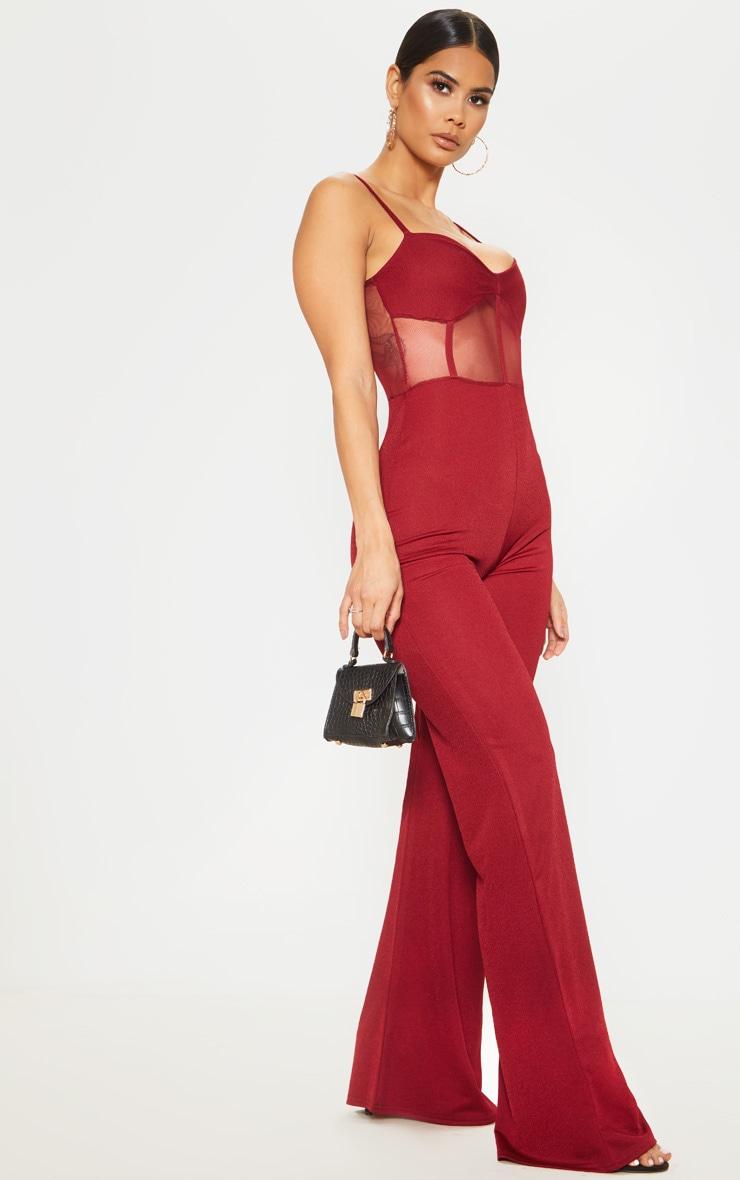 Combinaison en mesh rouge écarlate à buste corset et jambes évasées 1