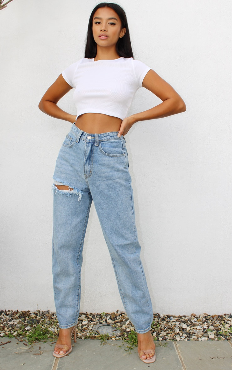PRETTYLITTLETHING Petite Light Blue Wash Thigh Distressed Mom Jean 1