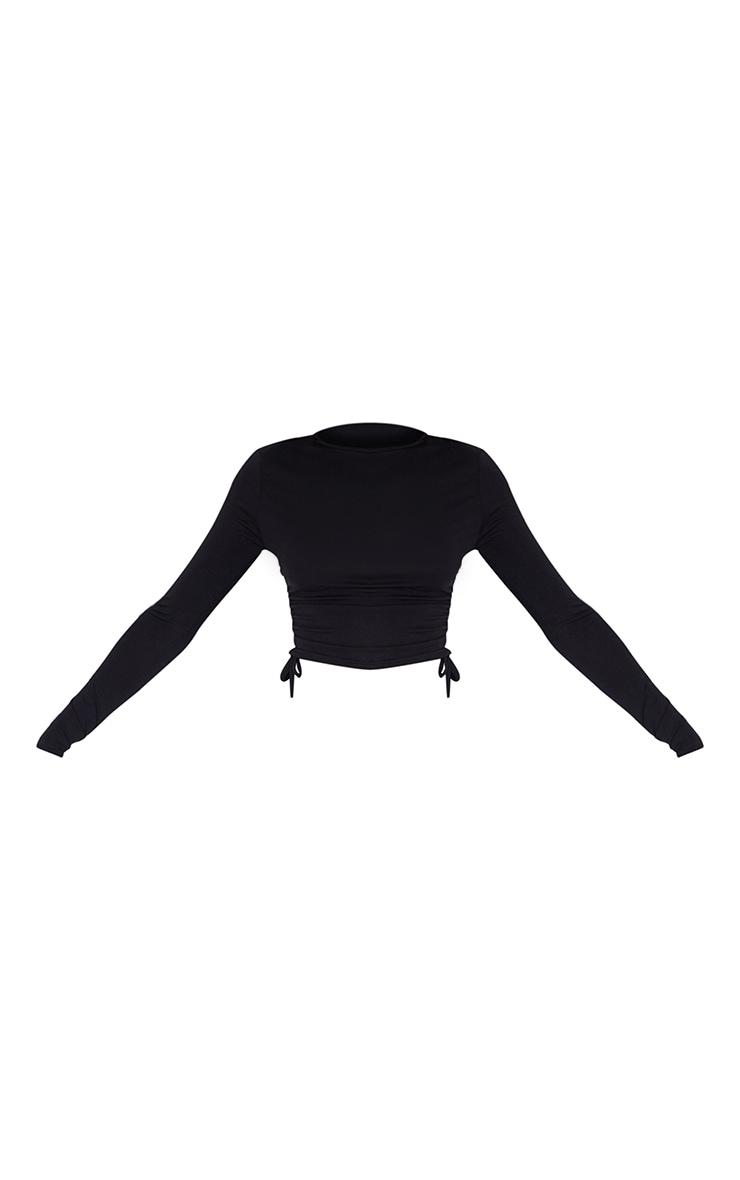 بلوزة باللون الأسود من قماش الجيرسيه بأكمام طويلة وكشكشة جانبية. 5
