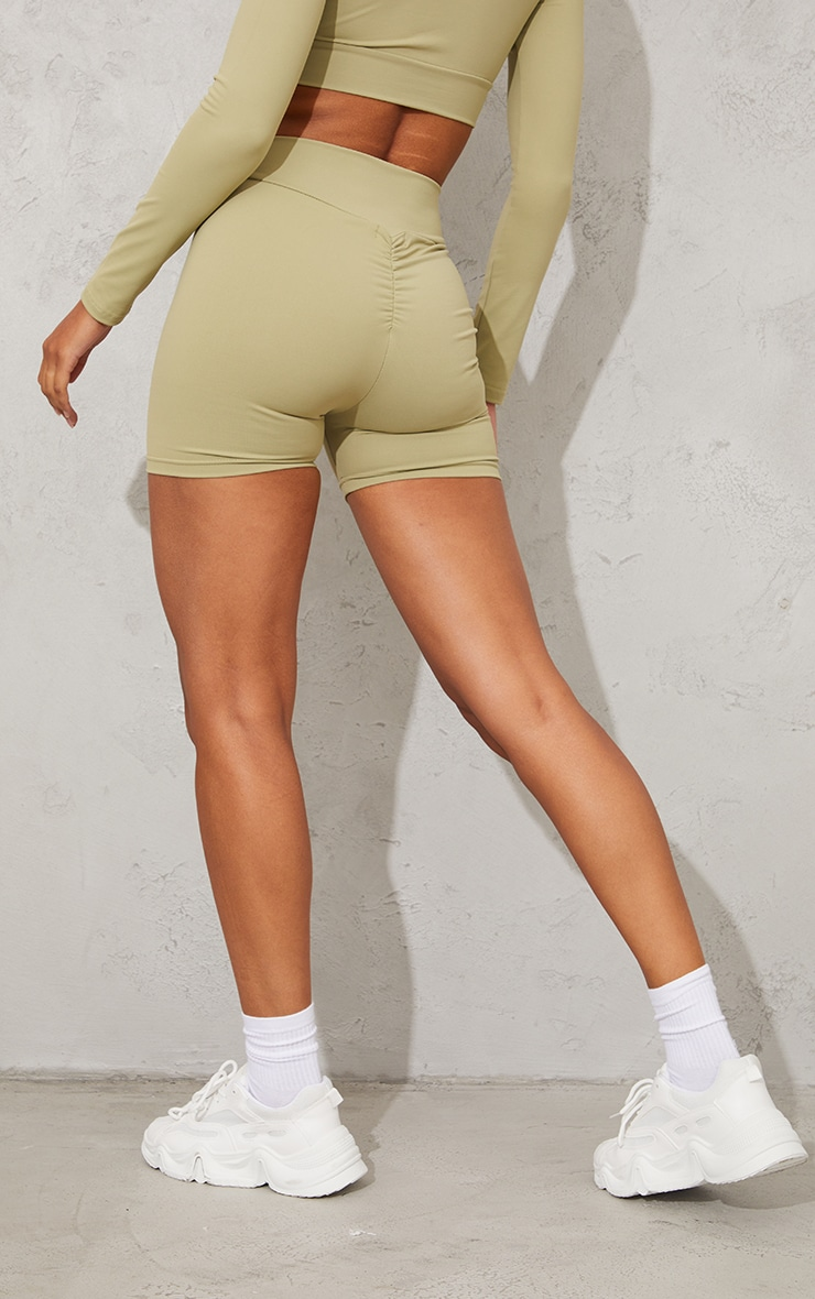 PRETTYLITTLETHING Olive Sport Cool Down Ruched Bum Cycle Shorts 3