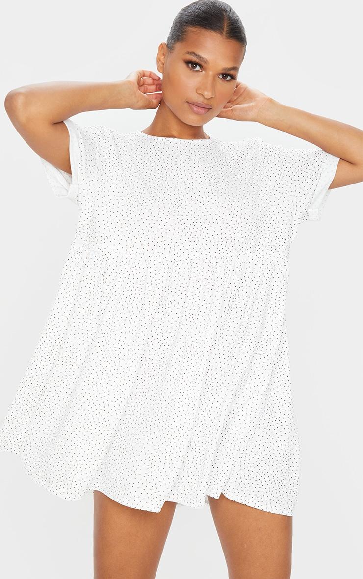 Robe babydoll blanche à pois et manches retroussées 1