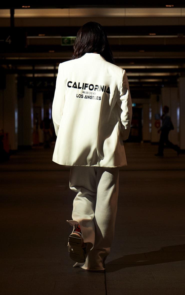 Blazer blanc oversize à slogan au dos 1