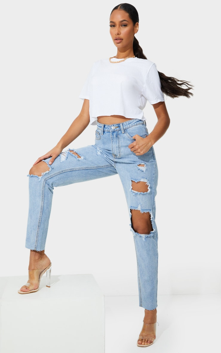 PRETTYLITTLETHING Light Blue Wash Extreme Distressed Slim Fit Mom Jeans 1
