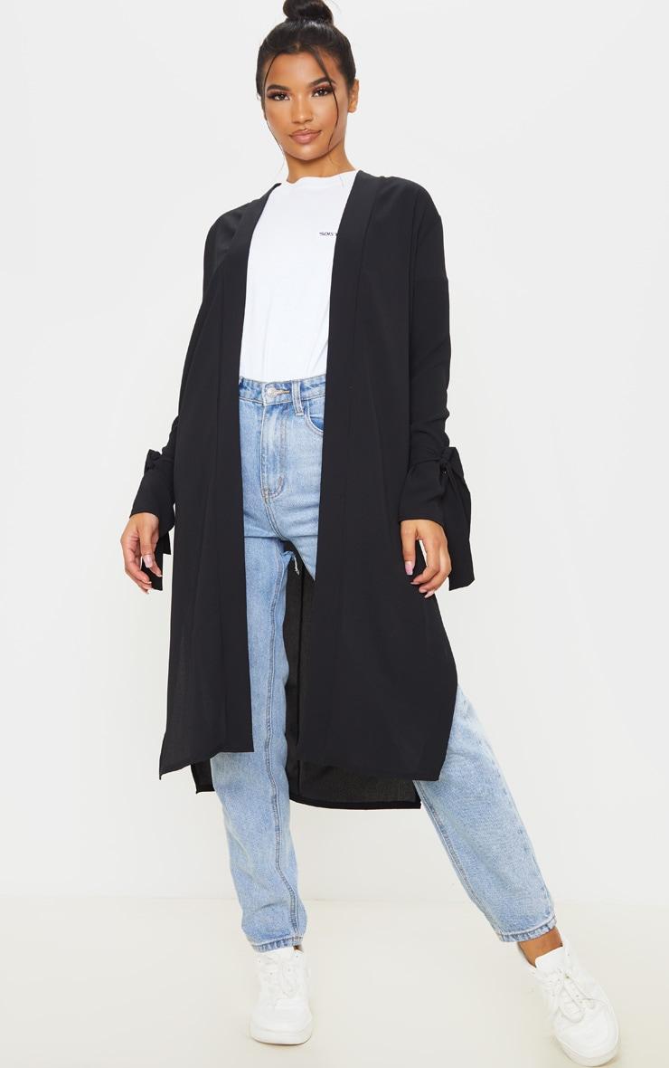 Aba manteau ample noir à détail noué aux manches 1