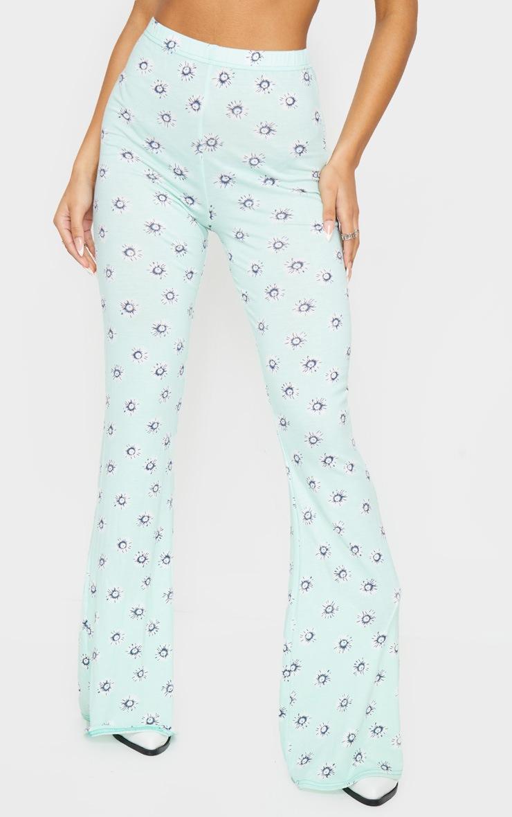 Pantalon en jersey menthe imprimé pâquerettes à taille haute et jambes évasées 2
