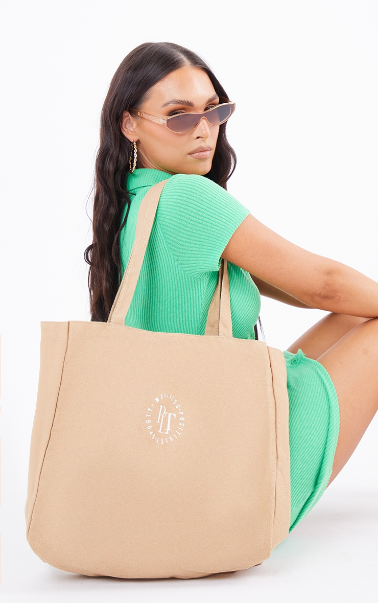 PRETTYLITTLETHING Tan Round Wellness Tote Bag 1