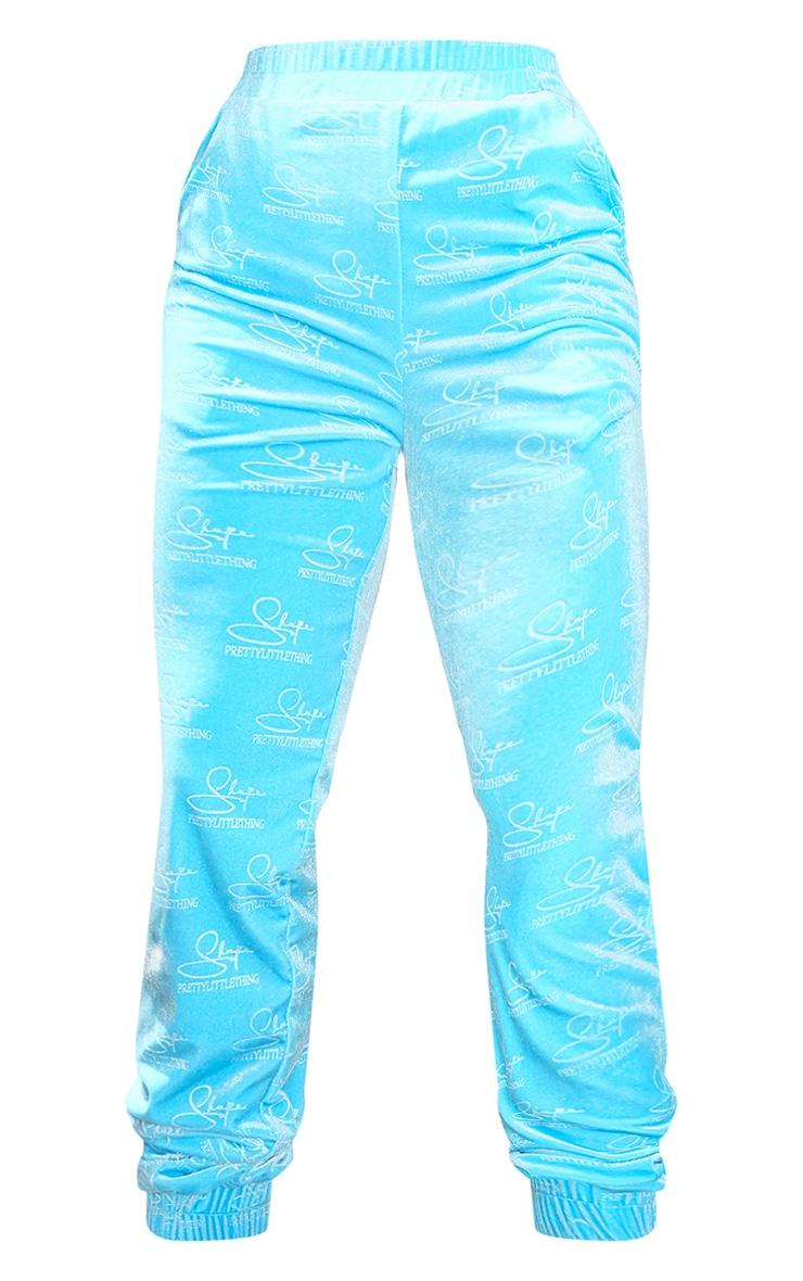 PRETTYLITTLETHING Shape - Jogging en velours bleu ciel à logos relief 5